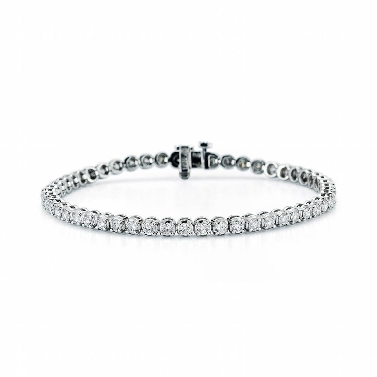 7.12 Carat Diamond Line Tennis Bracelet, in 18K white gold, by The Diamond Oak With 43 perfectly matched ( .16cts , 3.5mm each) round brilliant diamonds , with exceptional G color and VS clarity.   Bracelet is  exceptional craftsmanship. Total carat