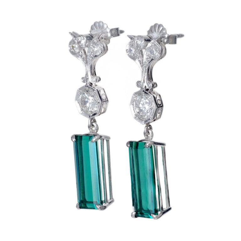 Vintage 1920's Art Deco tourmaline handmade dangle earrings. Set in platinum with 8 old euro accent diamonds. 2 rectangular cut green tourmaline dangles.   2 rectangular cut bluish green tourmalines, VS2 approx. 7.13cts 2 old European cut diamonds,