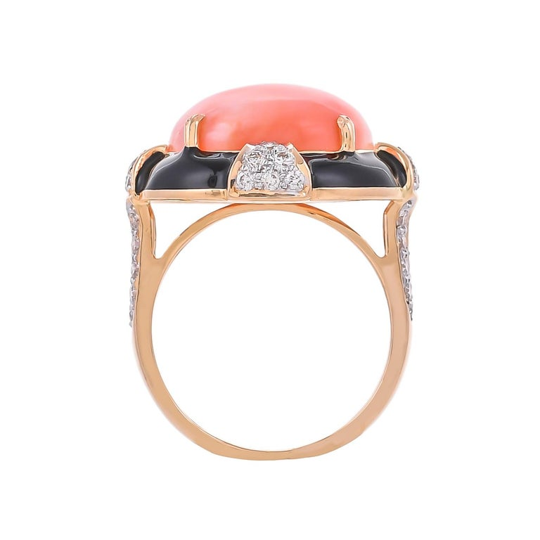 Modern and stylish this 18 karat ring features a bold, geometric shape set with the eccentric combination of 7.14 carats coral surrounded by sparkling white 0.62 carats diamonds and solid black enamel, highlights this statement yellow gold