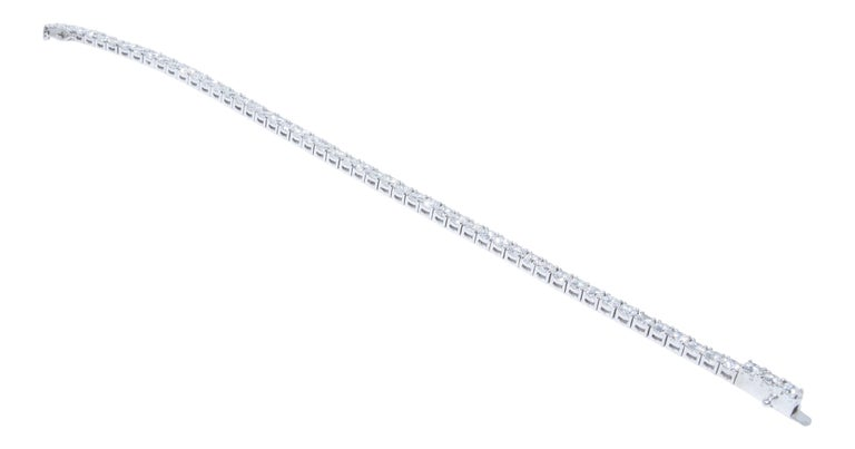 14k white gold bracelet containing 7.16 carats of prong set diamonds. The color and clarity grades of the diamonds contained within the bracelet are E-F, SI2-I1, respectively. The average polish, symmetry, and cut grade for each of these diamonds is