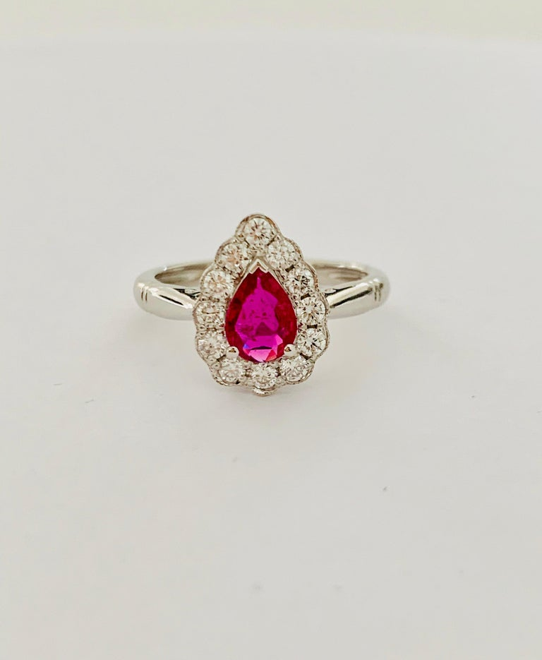 This exquisite 'ruby red' pear cut *Ruby is mounted in an 18 ct White Gold mount which is set with 12 Round Brilliant Cut Diamonds of G Colour and SI Clarity, weighing 0.36 ct in total.  This beautiful Ruby has wonderful clarity which can be seen in
