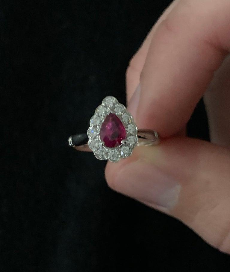 Modern .71 Carat Pear Cut Ruby Set in 0.36 Carat Diamond Surround of 18 Carat Gold For Sale