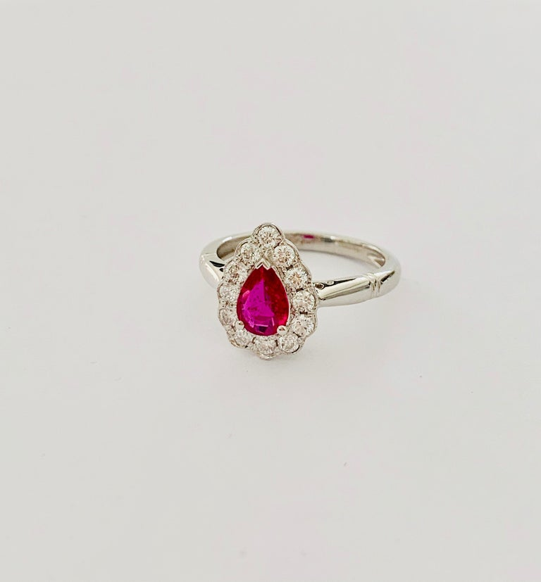 Women's .71 Carat Pear Cut Ruby Set in 0.36 Carat Diamond Surround of 18 Carat Gold For Sale