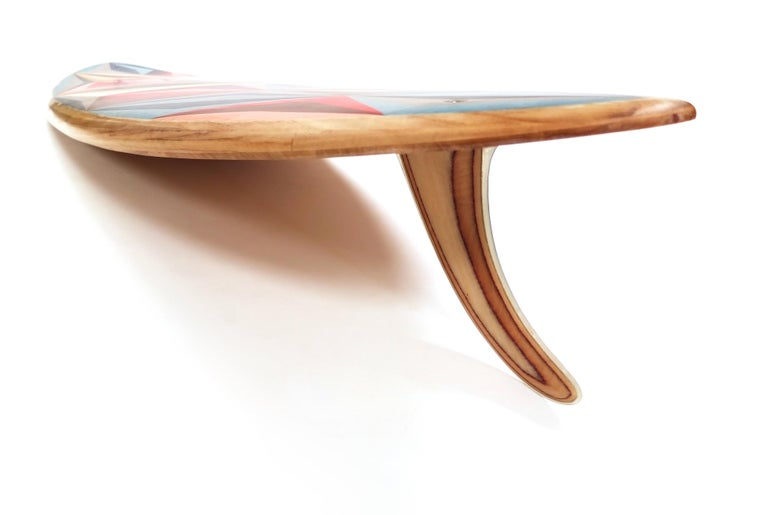 This is a unique custom surfboard featuring a marquetry deck, designed and hand-crafted by the w o o d p o p studio which specialises in marquetry and inlay work.   The studio prides itself on constantly challenging the limits of where and how