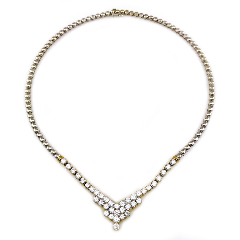 18 Karat Two-Tone Diamond Necklace, 7.20 Carat. Thirty-eight round invisibly set diamonds forming a peak adorn this truly stunning necklace. Diamonds are set in multi-tiered yellow gold bezels. Diamonds are VS1 (G.I.A.) in clarity and G (G.I.A.) in