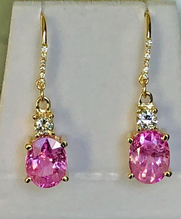 100% Natural Burmese Sapphires Cut : Oval Cut Average Color/clarity : Magnificent Pink/ Clarity VS Total Weight Sapphires: 6.75 Carats (2 Stones) Second Stones: Diamond 0.50 Carats Average Color And Clarity: G-H/ VS Total Gemstones Weight: 7.25