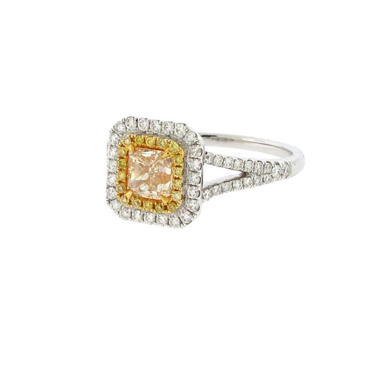 This is a huge looking ring for not a huge amount of money. Almost a 1ct center yellow diamond set in a double halo with yellow and white diamonds. The halo ring is the most popular setting style these days and yellow diamonds are making a big
