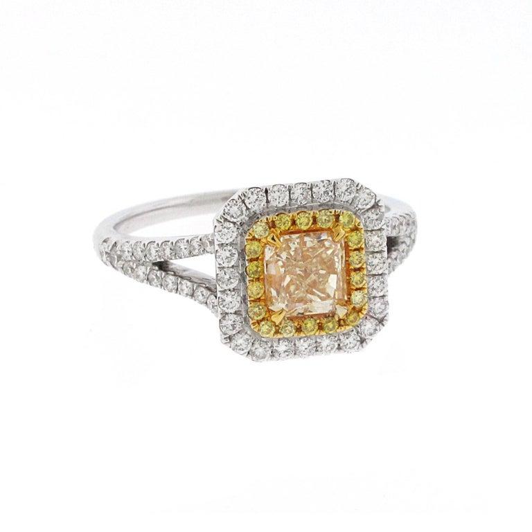 Modern .73 Carat Radiant Cut Yellow Diamond Engagement Ring, 18 Karat White Gold For Sale