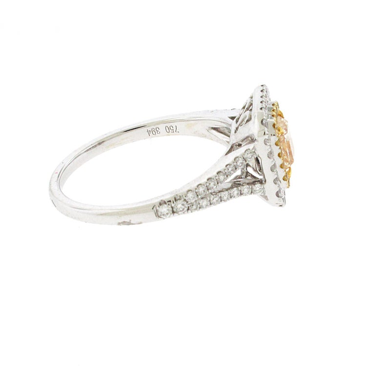 .73 Carat Radiant Cut Yellow Diamond Engagement Ring, 18 Karat White Gold In Excellent Condition For Sale In Beverly Hills, CA