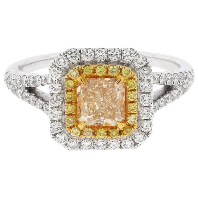 .73 Carat Radiant Cut Yellow Diamond Engagement Ring, 18 Karat White Gold For Sale