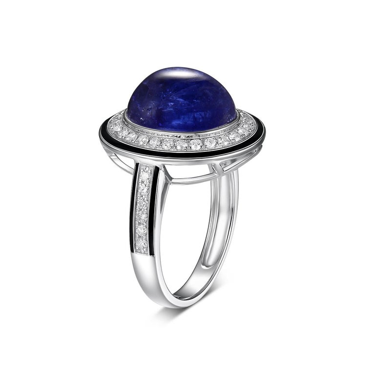 This ring features a 7.30 carat tanzanite set in 18 karat white gold, assented with 0.40 carat of round diamond. The diamond halo is outlined with black enamel. A simple yet modern design. Truly a special gift for that special someone.  18 Karat