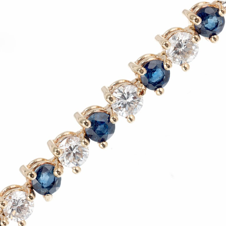 Sapphire and diamond link bracelet.  18k yellow gold,  three prong basket hinged link bracelet.   21 Diamonds approx. total weight 4.20cts, H to I, VS1-VS2 21 Blue Sapphires approx. total weight 3.15cts 18k Yellow Gold Stamped: 750 = 18k 12.6