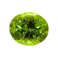 7.36 Carat Natural Unheated Oval-Cut Burmese Vivid Green Peridot