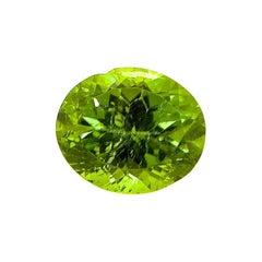 7.36 Carat Natural Unheated Oval-Cut Burmese Vivid Green Peridot