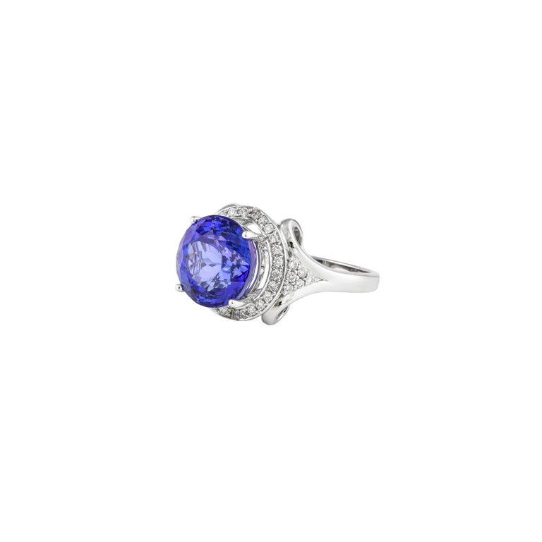 Round Cut 7.4 Carat Tanzanite and White Diamond Ring in 18 Karat White Gold For Sale