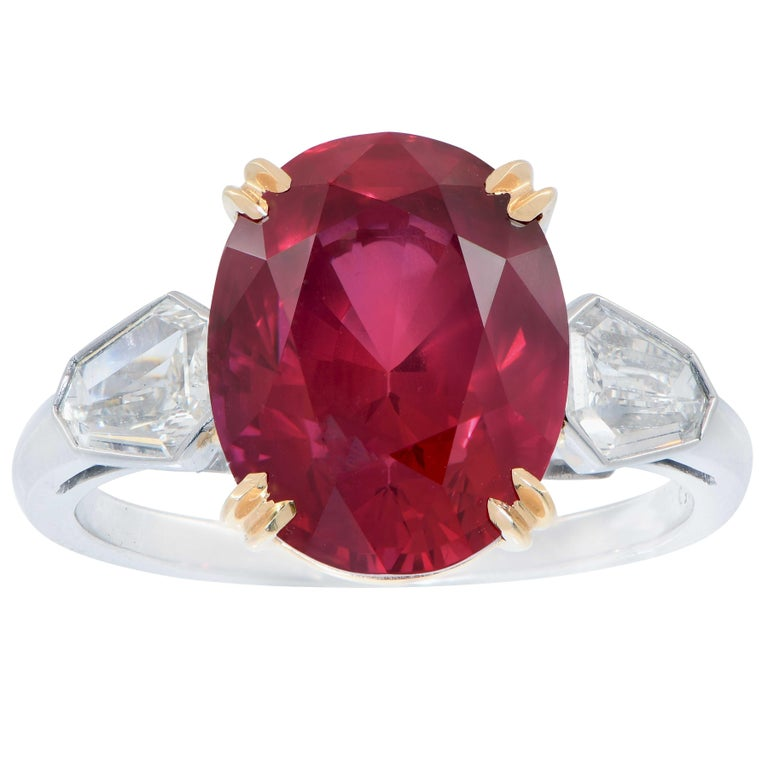 7.47 Carat GRS Graded No Heat Mozambique Oval Cut Ruby and Diamond Ring Features an exquisite pigeon's blood vivid red ruby with excellent crystal and proportions. This gorgeous ruby is set in a platinum mounting with two kite facet cut diamonds in