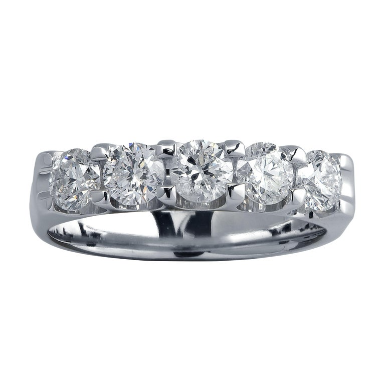 Stunning diamond band crafted in white gold featuring 5 round brilliant cut diamonds weighing approximately .75 carats total, G color SI2-3 clarity. This timelessly elegant ring is a size 4.25 and measures 3.8 mm in width.  Our pieces are all