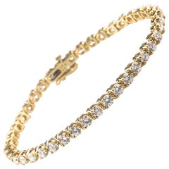 7.50 Carat Round Diamond 14 Karat Yellow Gold Tennis Bracelet
