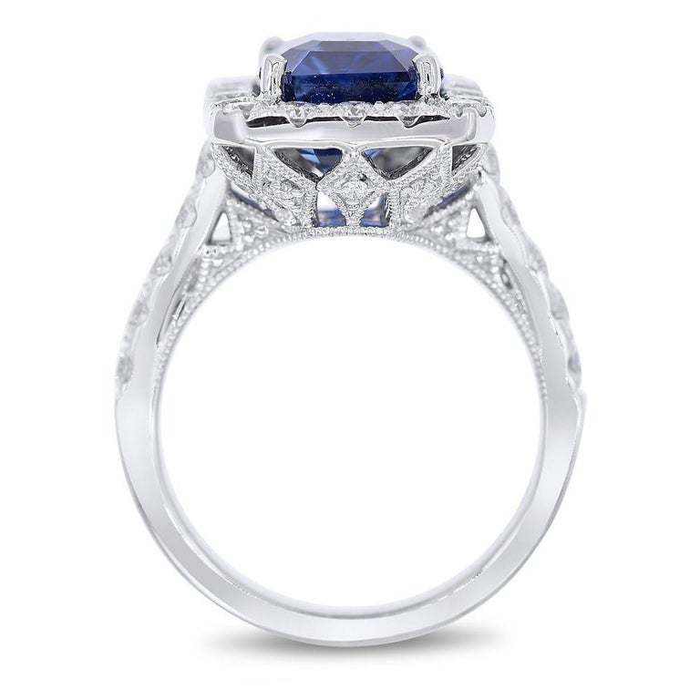 Royal blue Sapphire and Diamond ring  18K white gold ring with 5.76 Carats Sapphire in the center, Emerald cut, surrounded by 1.50 carats of diamonds.   Diamond specifications: G-H color, SI clarity  This product comes with a certificate of