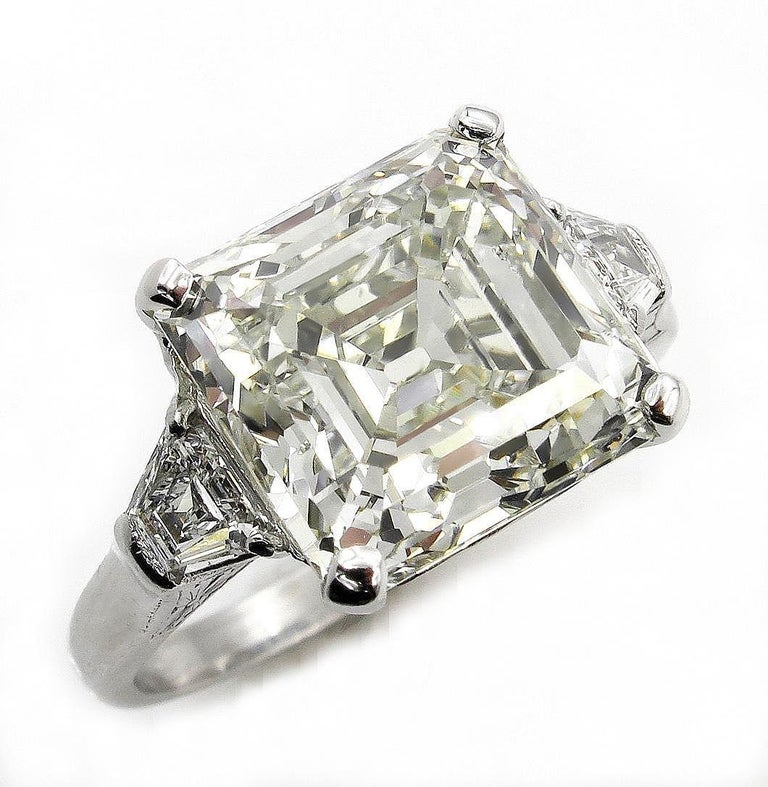 This Impressive Art Deco Style Three-Stone Ring will take your breath away! Important 100% NATURAL NONE-treated diamond! Sleek, Timeless Sophisticated Sparkler with Beautiful Bright and Clean  ASSCHER. Square Emerald/Step Cut diamond, weighing a Shy