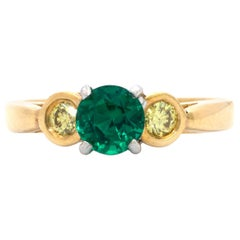 .76 Carat Round Emerald and .25 Carat Fancy Yellow Diamond 3 Stone 18k Gold Ring
