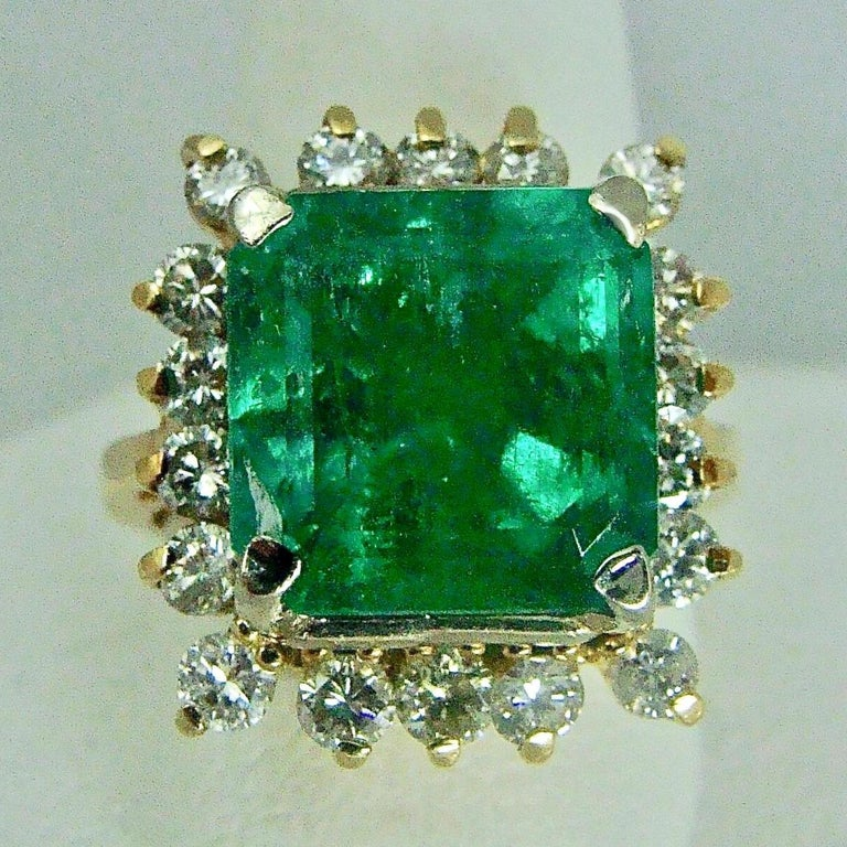 Emerald Cut 7.60 Carat Natural Colombian Emerald and Diamond Ring For Sale