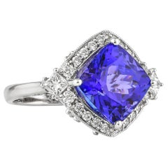 7.62 Carat Cushion Shaped Tanzanite Ring in 18 Karat White Gold With Diamonds