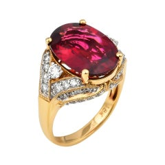 7.65 Carat Oval Shaped Rubelite Ring in 18 Karat Yellow Gold with Diamonds