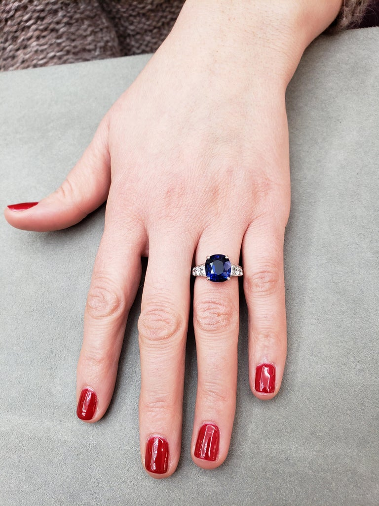 Contemporary 7.66 Carat Blue Sapphire and Diamond Graduating Pave Engagement Ring For Sale
