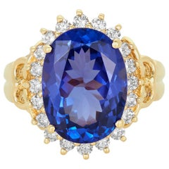 7.66 Carat Oval Shaped Tanzanite White Diamond Halo Ring 14 Karat Yellow Gold
