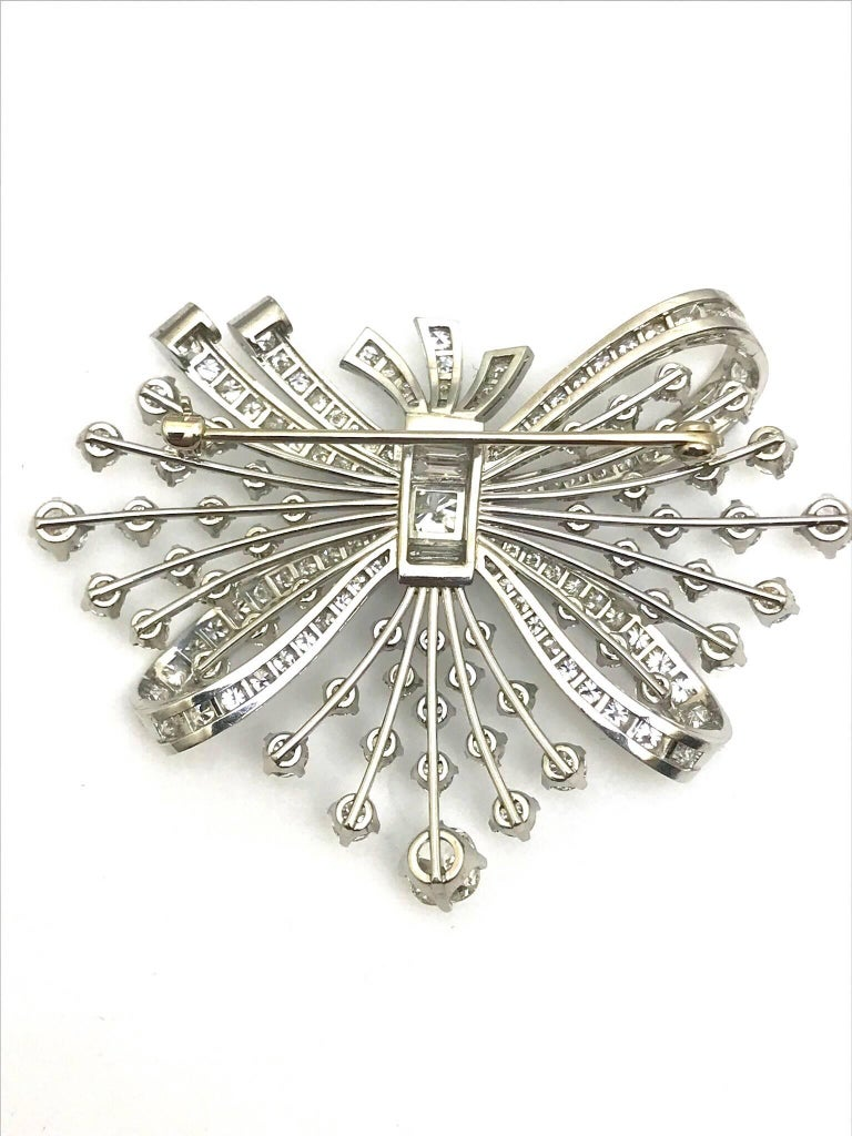 Round Cut 7.67 Carat Round and Baguette Diamond Platinum Spray Bow Brooch For Sale