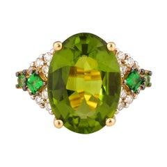 7.7 Carat Peridot with Tsavorite and Diamond Ring in 18 Karat Yellow Gold