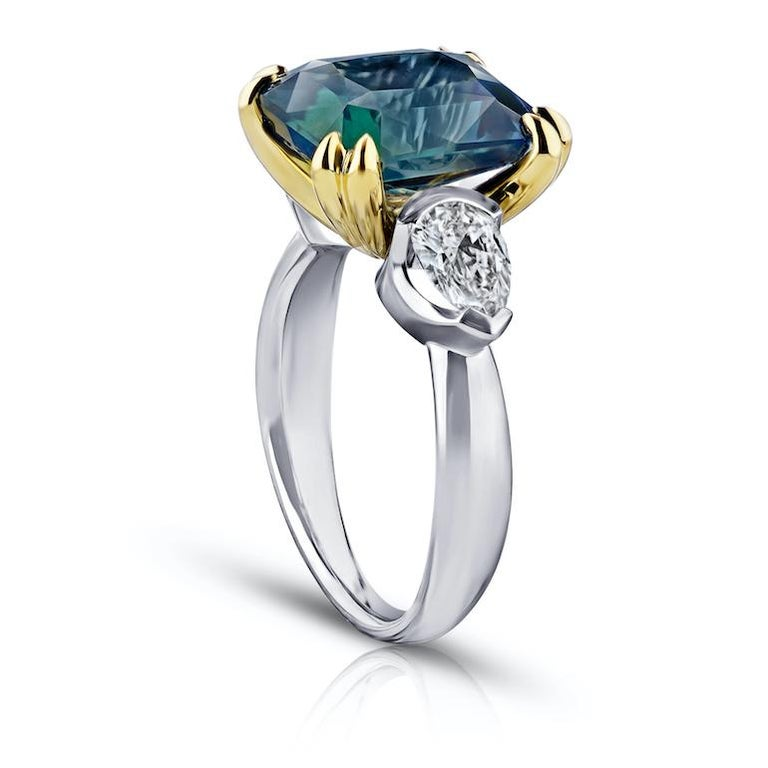 7.70 carat radiant cut (natural no heat) green sapphire with pear shape diamonds 1.05 carats set in a platinum with 18k yellow gold ring.