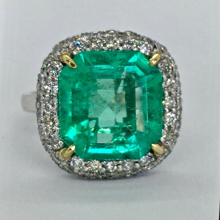 Stunning Extra Fine Natural Colombia Emerald, Diamond and 18K white Gold handmade Engagement Ring from our Workshop. Fine Natural Colombian Emerald octagonal faceted 5.73 Carats 12.60mm x 11.85mm x 6.30mm Color: AAAA vivid medium green  Saturation: