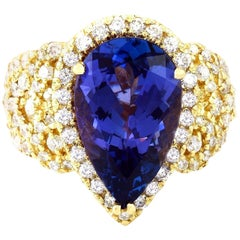7.73 Carat Tanzanite 18 Karat Solid Yellow Gold Diamond Ring