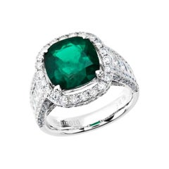 7.74 Carat Cushion Cut Colombian Emerald and Diamond Ring in 18 Karat White Gold