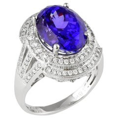 7.75 Carat Oval Shaped Tanzanite Ring in 18 Karat White Gold with Diamonds