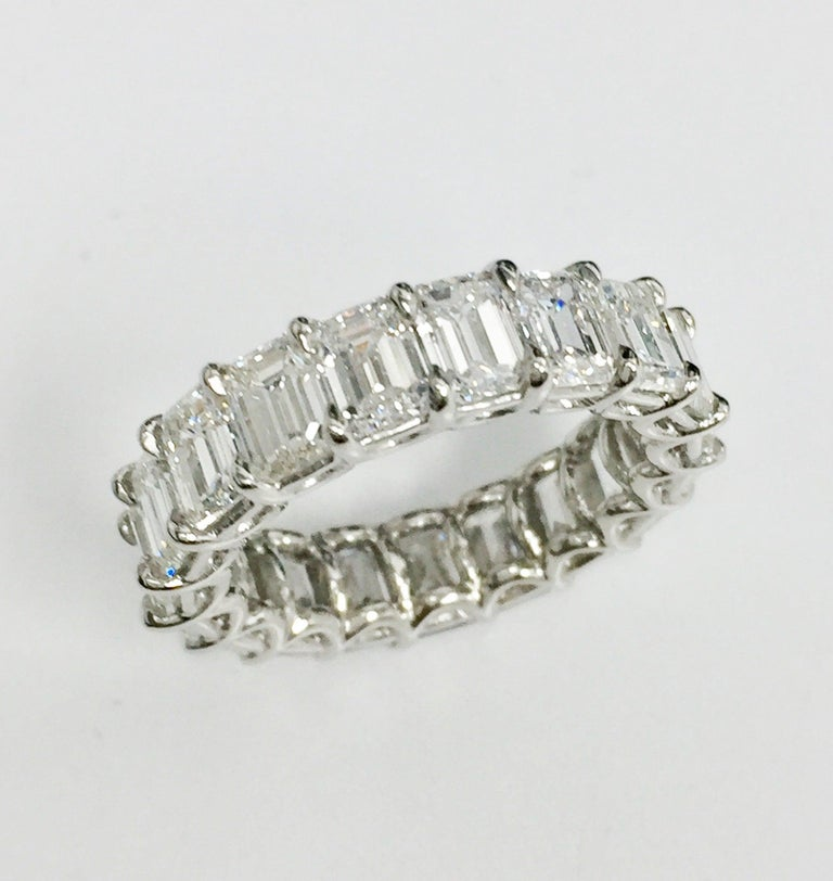 19 Elongated and perfectly matched Emerald Cut Diamond make up this Eternity Band. 7.77 Carats. G-H, VS Quality. Set in Platinum. Size 6.
