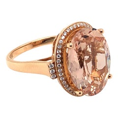 7.77 Carat Oval Shaped Morganite Ring in 18 Karat Rose Gold with Diamonds