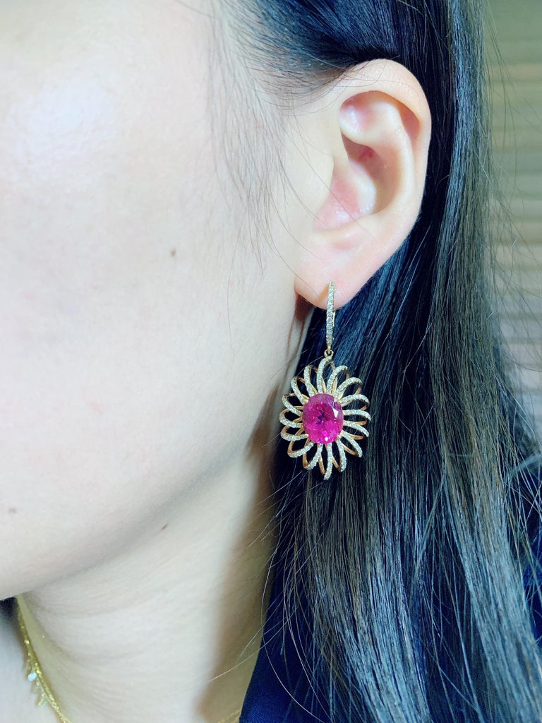 This pair of earring , with 7.8ct rubelite center stone. With white diamond design in rose gold. Classic and easy to wear in any occasion.   Kahn also provide engraving, resizing and cleaning service for customer. All the production are in Hong Kong