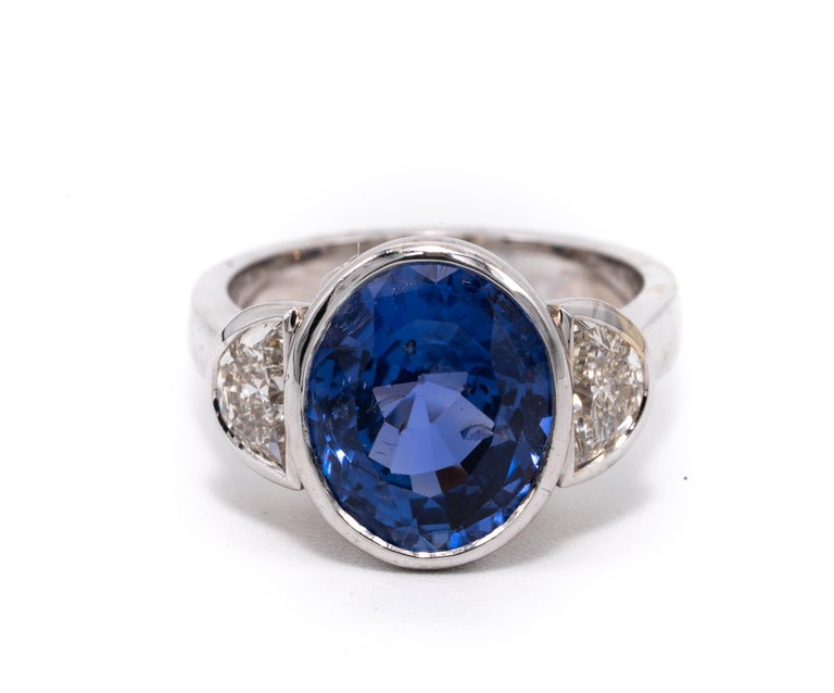 7.81 Carat Natural Oval Cut Sapphire ( No heat treatment) and diamond ring.   GIA Grading report stating Sapphire is natural with no treatment ( cert # 1146604585)  Ring is highlighted with  matching half moon diamonds Summary: Center: 7.81 Ct Oval