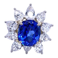 7.86 Carat Oval Tanzanite Floral Style Split Shank 4.79 Carat Diamond Ring