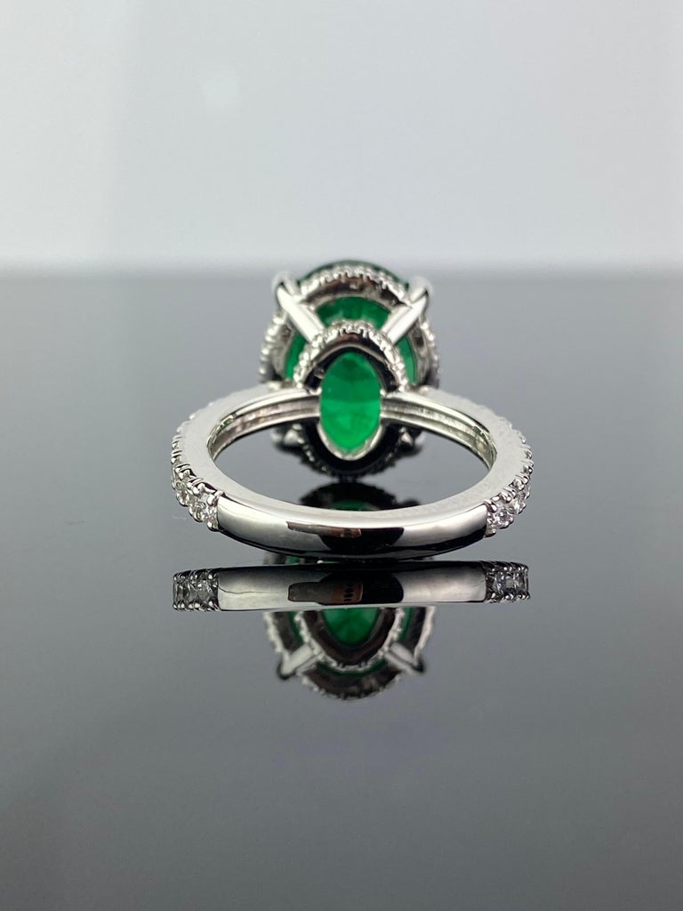 Modern 7.87 Carat Oval Emerald and Diamond Engagement Ring For Sale