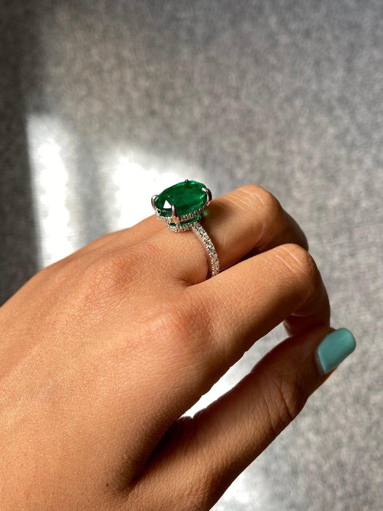 Women's 7.87 Carat Oval Emerald and Diamond Engagement Ring For Sale