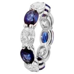 7.97 Carat Sapphire and Oval Diamond East West Eternity Band Ring