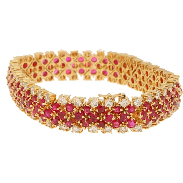 This truly stunning ruby and diamond bracelet features 114 single cut rubies totalling an estimated 7.98 carats and 76 single cut diamonds totalling an estimated 3.8 carats. This bracelet is set in 18 karat yellow gold with a beautifully crafted