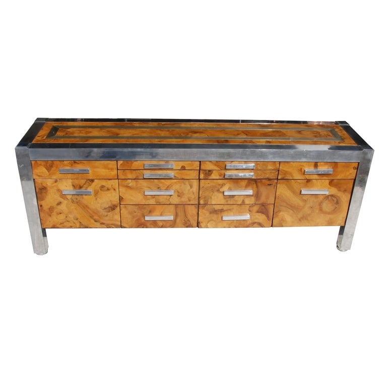Pace Collection burled wood and chrome credenza  Features chrome detailing, and a light burled wood.  Has ample storage space, 12 drawers.