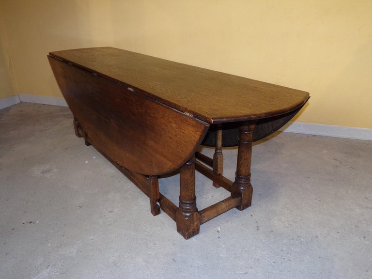 A grand sold oak English oval double gate gateleg table to seat 8-10 people, This magnificent table has