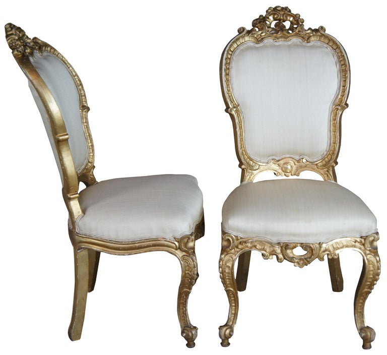 Suite of 8 Swedish gilt and gesso Louis XV/Rococo side chairs, Circa mid 18th century. Features an ornately scalloped frame with shell carvings on the apron and crest. Upholstered in a neutral silk fabric with horsehair fill. Supported by cabriole