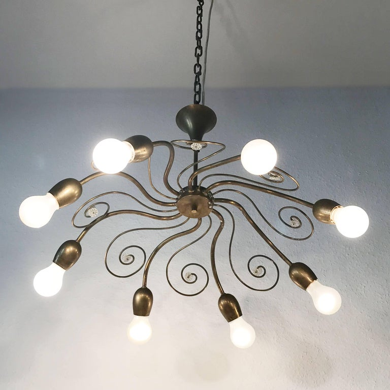 Exceptional Mid-Century Modern eight-armed chandelier or pendant lamp in shape of a swirl. With bulb holders like buds. Designed and manufactured by J. & L. Lobmeyr, Vienna, Austria in 1950s. Executed completely in brass. The lamp needs eight E27